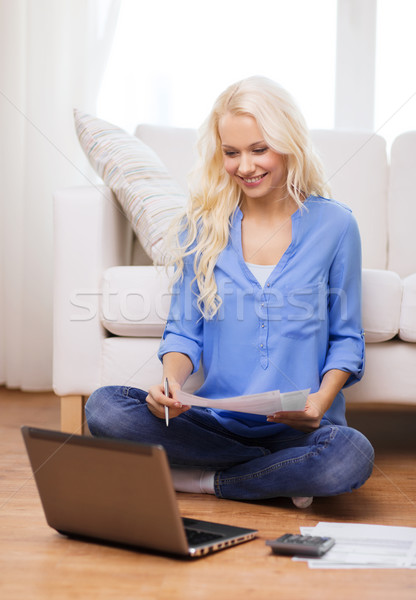 smiling woman with papers, laptop and calculator Stock photo © dolgachov