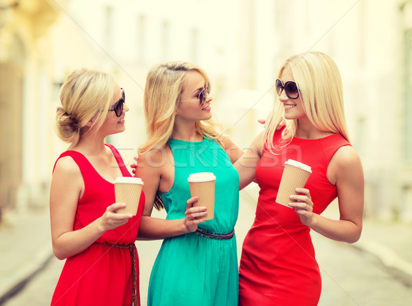 Stock photo: women with takeaway coffee cups in the city
