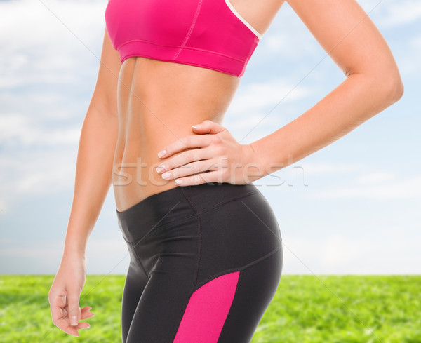close up of female abs in sportswear Stock photo © dolgachov