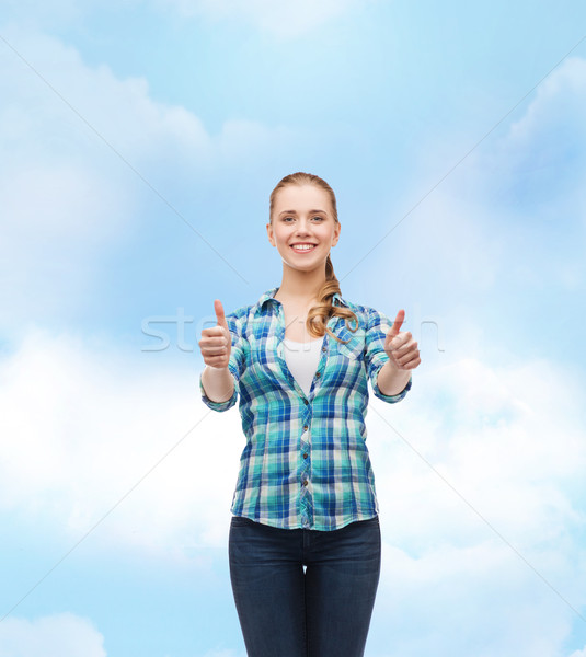 young woman in casual clothes showing thumbs up Stock photo © dolgachov