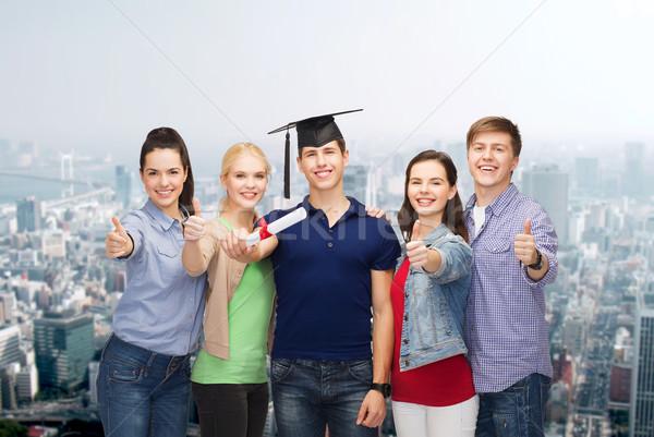 Grupo estudiantes diploma educación Foto stock © dolgachov