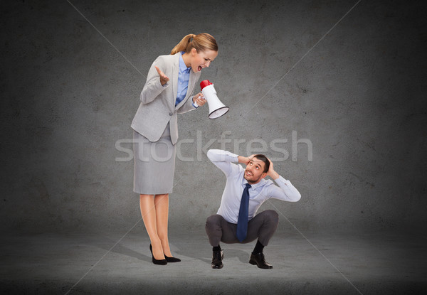 angry businesswoman with megaphone Stock photo © dolgachov