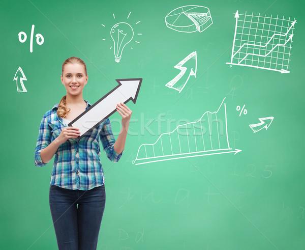 smiling student girl with white arrow pointing up Stock photo © dolgachov