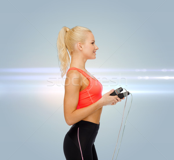 smiling sporty woman with skipping rope Stock photo © dolgachov