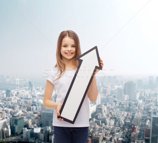 smiling little girl with blank arrow pointing up Stock photo © dolgachov
