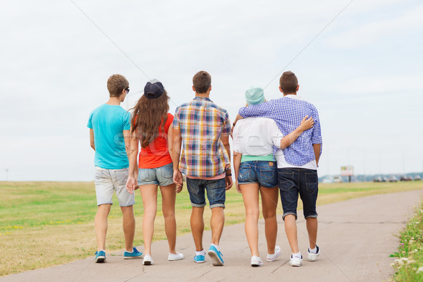group of teenagers walking outdoors from back Stock photo © dolgachov