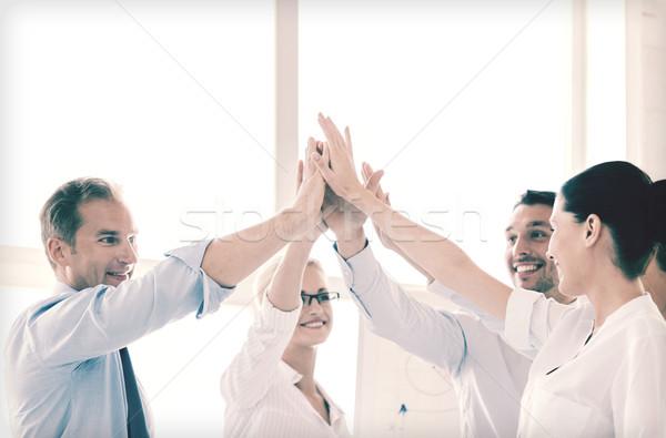 Heureux équipe commerciale high five bureau succès gagner Photo stock © dolgachov