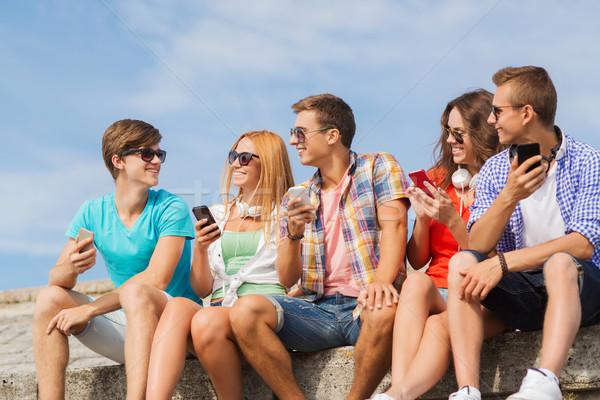 группа улыбаясь друзей улице дружбы Сток-фото © dolgachov