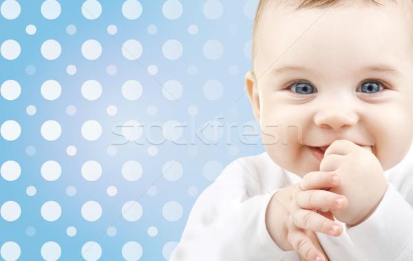 smiling baby boy face over blue polka dots Stock photo © dolgachov