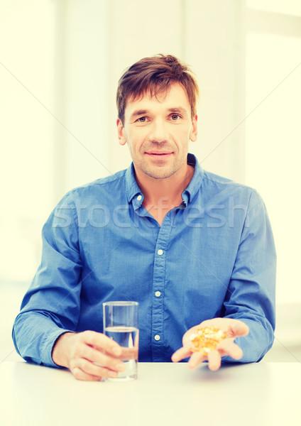 man at home showing lot of pills Stock photo © dolgachov