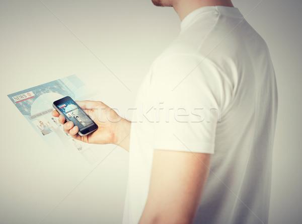 man with smartphone reading news Stock photo © dolgachov