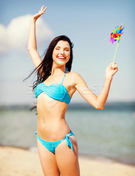 Nina molino de viento juguete playa verano vacaciones Foto stock © dolgachov