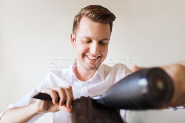 Heureux styliste fan salon beauté Photo stock © dolgachov