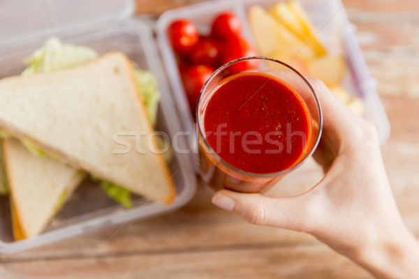 Vrouw hand tomatensap glas Stockfoto © dolgachov