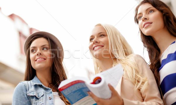 Bella ragazze città guidare libro vacanze Foto d'archivio © dolgachov