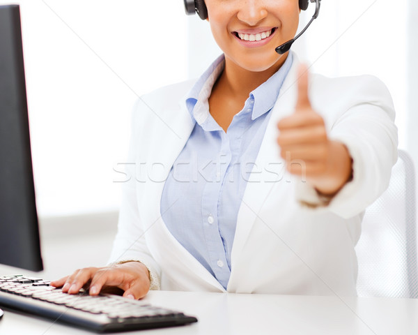 african female helpline operator showing thumbs up Stock photo © dolgachov
