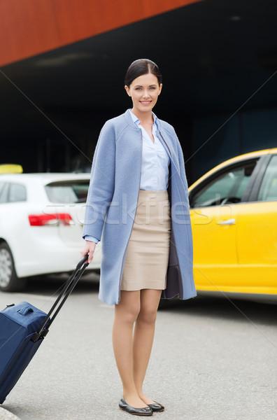 улыбаясь путешествия сумку такси командировка Сток-фото © dolgachov