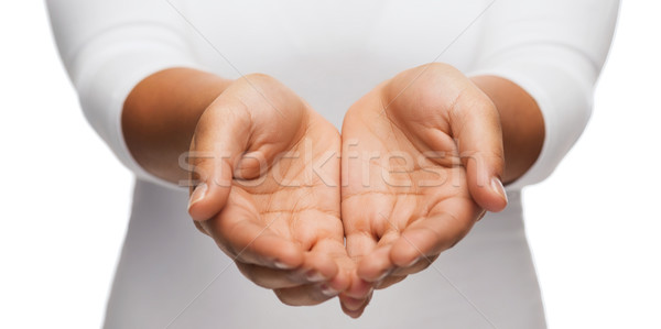 Stock photo: womans cupped hands showing something