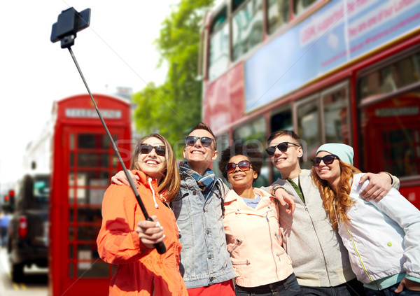 friends taking selfie with smartphone in london Stock photo © dolgachov