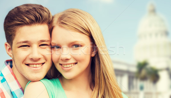 smiling couple over washington white house Stock photo © dolgachov
