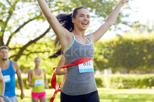 happy young female runner winning on race finish Stock photo © dolgachov
