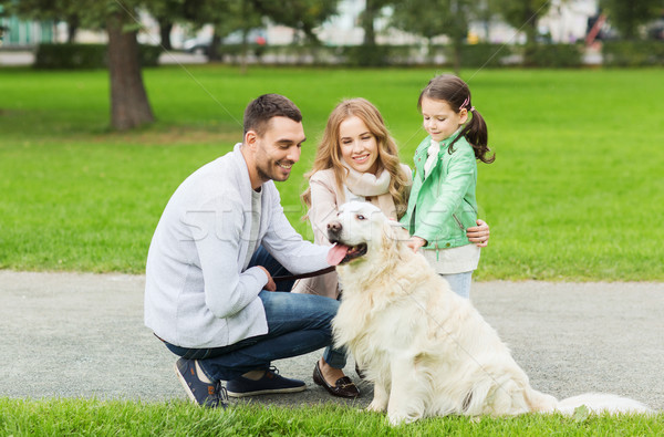 Stock photo: happy family with labrador retriever dog in park