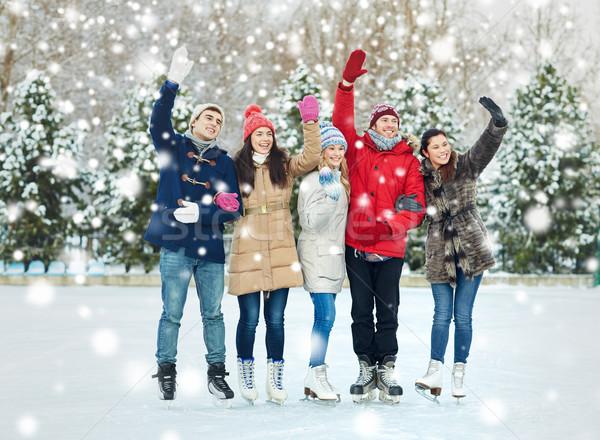 happy friends ice skating on rink outdoors Stock photo © dolgachov