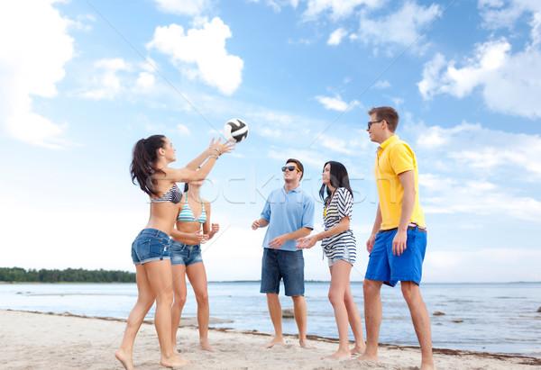 group of happy friends playing beach ball Stock photo © dolgachov
