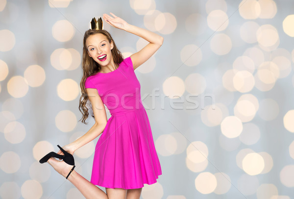 happy young woman in princess crown over lights Stock photo © dolgachov