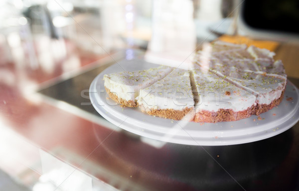 Stock photo: close up of cake on stand in cafe showcase