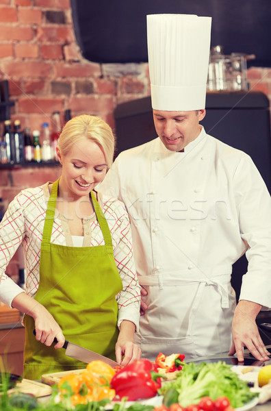 happy male chef cook with woman cooking in kitchen Stock photo © dolgachov