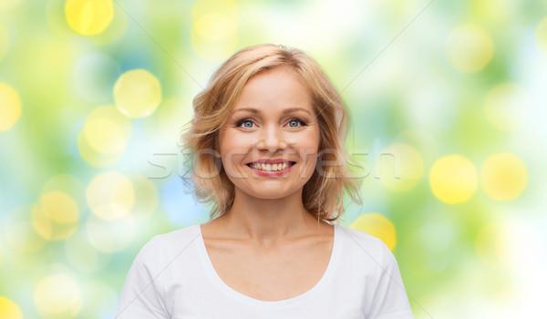 Femme souriante blanche tshirt bonheur personnes vert Photo stock © dolgachov