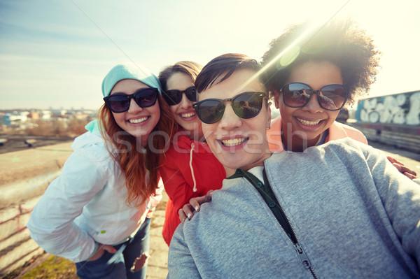 group of happy friends taking selfie on street Stock photo © dolgachov