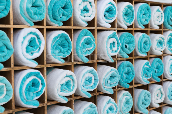 close up of shelf with rolled bath towels Stock photo © dolgachov