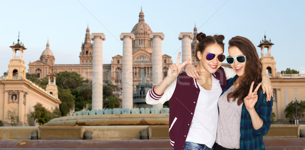 Stock photo: smiling teenage girls in sunglasses showing peace