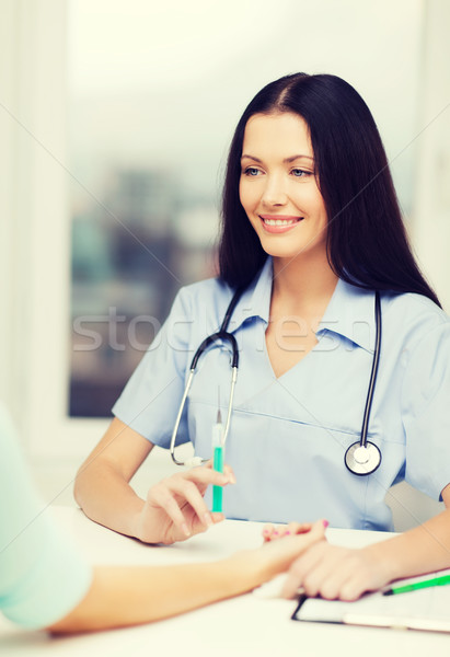 smiling female doctor or nurse with syringe Stock photo © dolgachov
