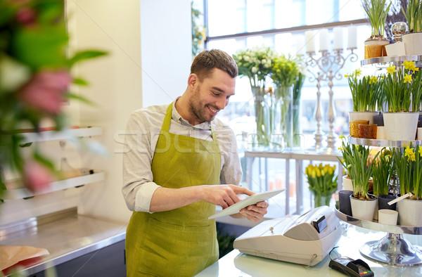 Férfi táblagép számítógép virágüzlet emberek üzlet Stock fotó © dolgachov