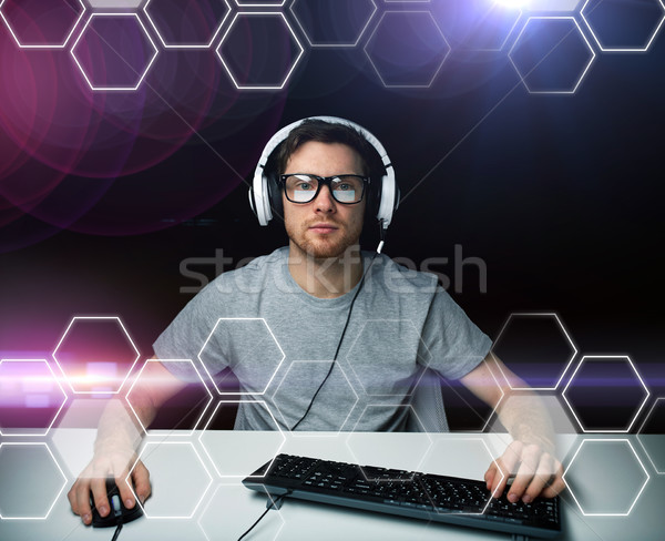 man in headset computer over hexagons projection Stock photo © dolgachov