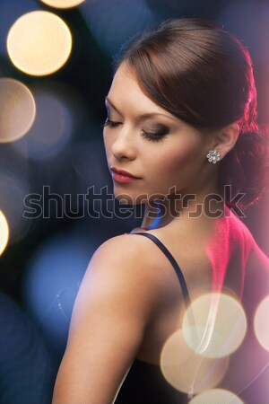 Bella giovani asian donna orecchino bellezza Foto d'archivio © dolgachov