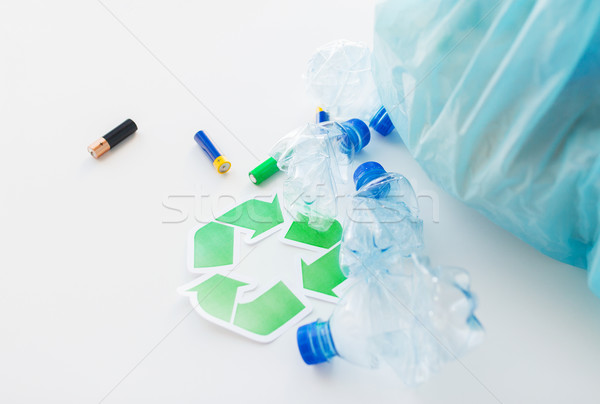 close up of used bottles and batteries recycling Stock photo © dolgachov