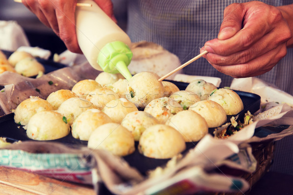 cook stuffing dough or rice balls at street market Stock photo © dolgachov