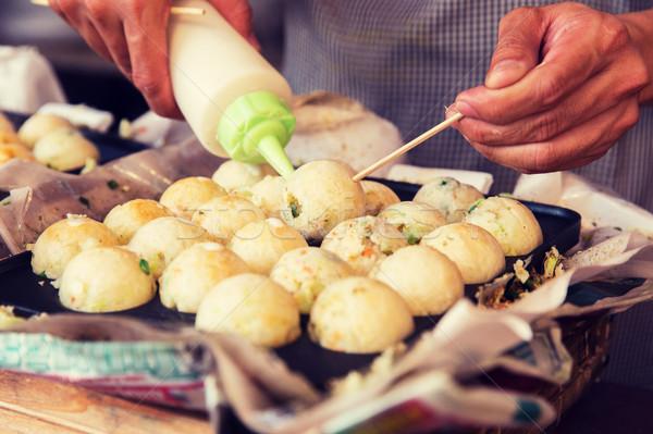 Szakács töltelék rizs golyók utca piac Stock fotó © dolgachov