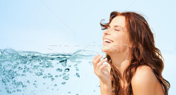 happy beautiful woman over lights background Stock photo © dolgachov