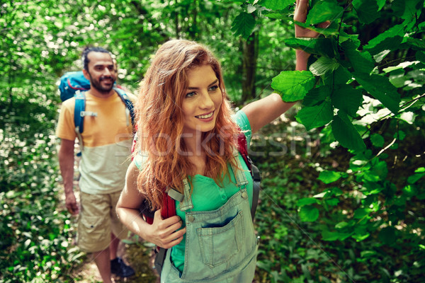 happy couple with backpacks hiking in woods Stock photo © dolgachov