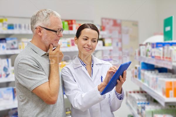 pharmacist with tablet pc and senior man Stock photo © dolgachov
