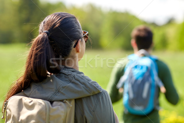 close up of couple with backpacks hiking outdoors Stock photo © dolgachov
