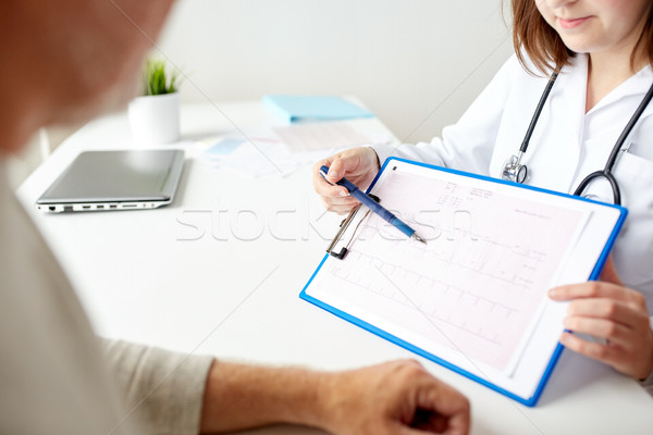 senior man and doctor with cardiogram at hospital Stock photo © dolgachov
