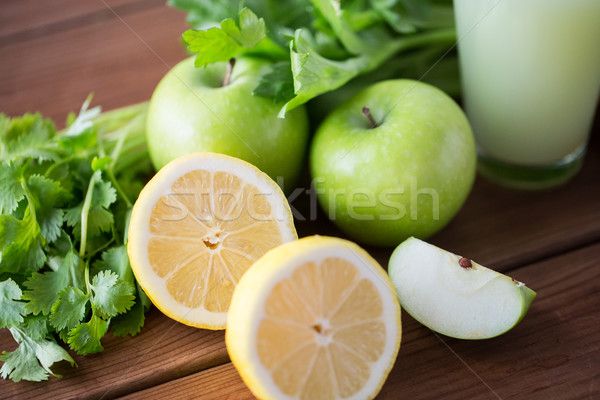 close up of lemons, apples, celery and green juice Stock photo © dolgachov