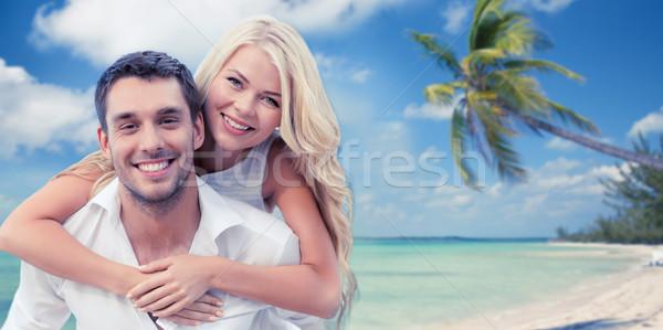 happy couple having fun over beach background Stock photo © dolgachov