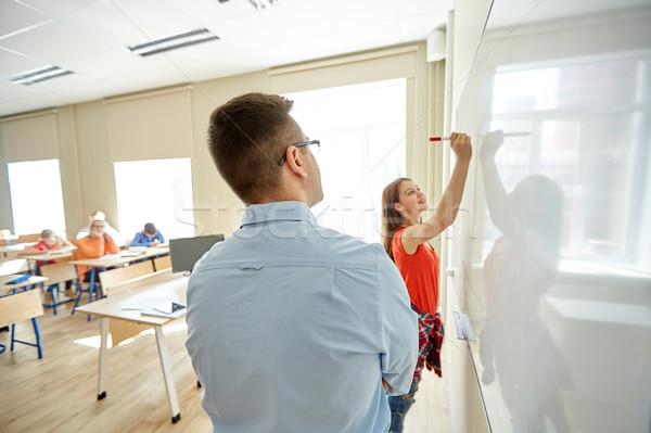 Leraar student schrijven boord school onderwijs Stockfoto © dolgachov